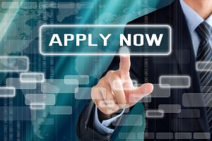 businessman finger touching 'apply now' button
